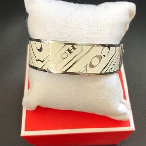 Coach stainless and white enamel bangle bracelet